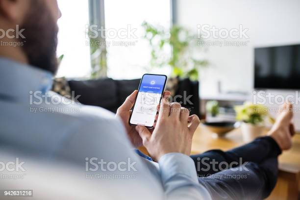 Man holding a smartphone with smart home screen picture id942631216?b=1&k=6&m=942631216&s=612x612&h=ryqvjmz3gpsljskejprywx9rud80qepslvhleapg9j4=