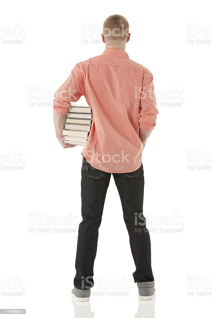 Man holding a stack of books royalty-free stock photo