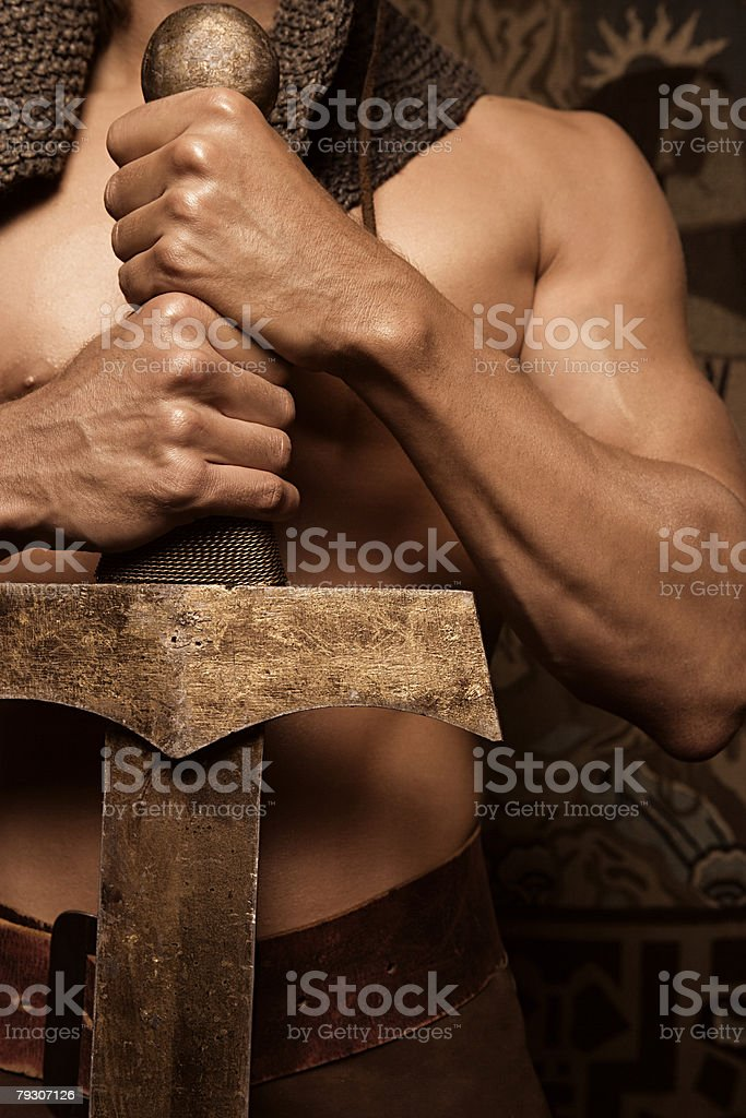 Man holding a sword royalty-free stock photo