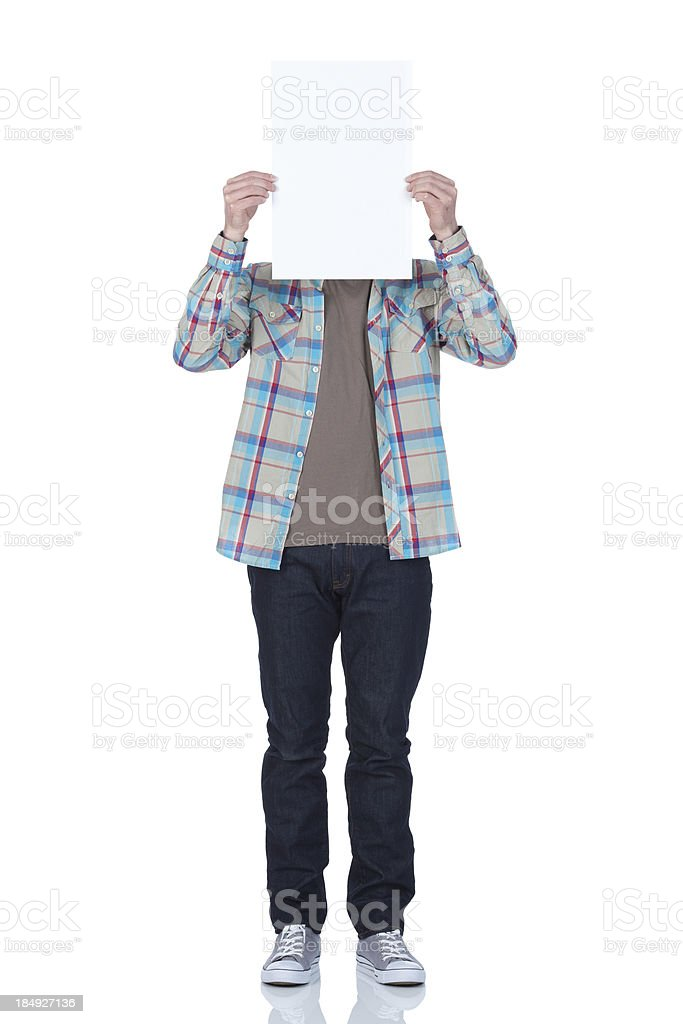 Man holding a white card in front of his face royalty-free stock photo