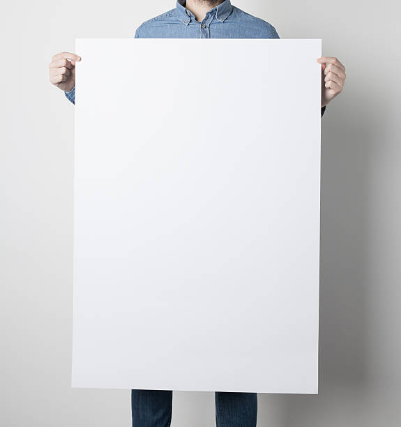 Man holding a white poster stock photo