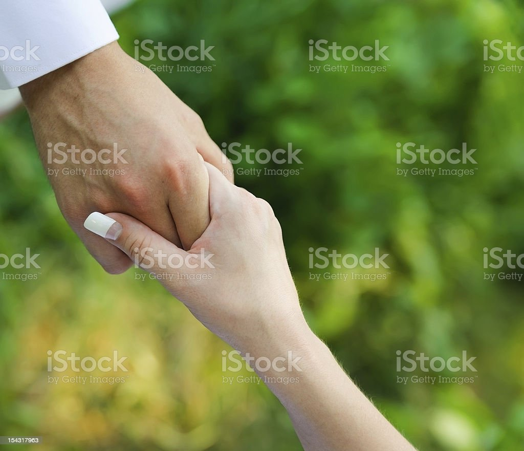 man holding a woman hand. male assistance royalty-free stock photo