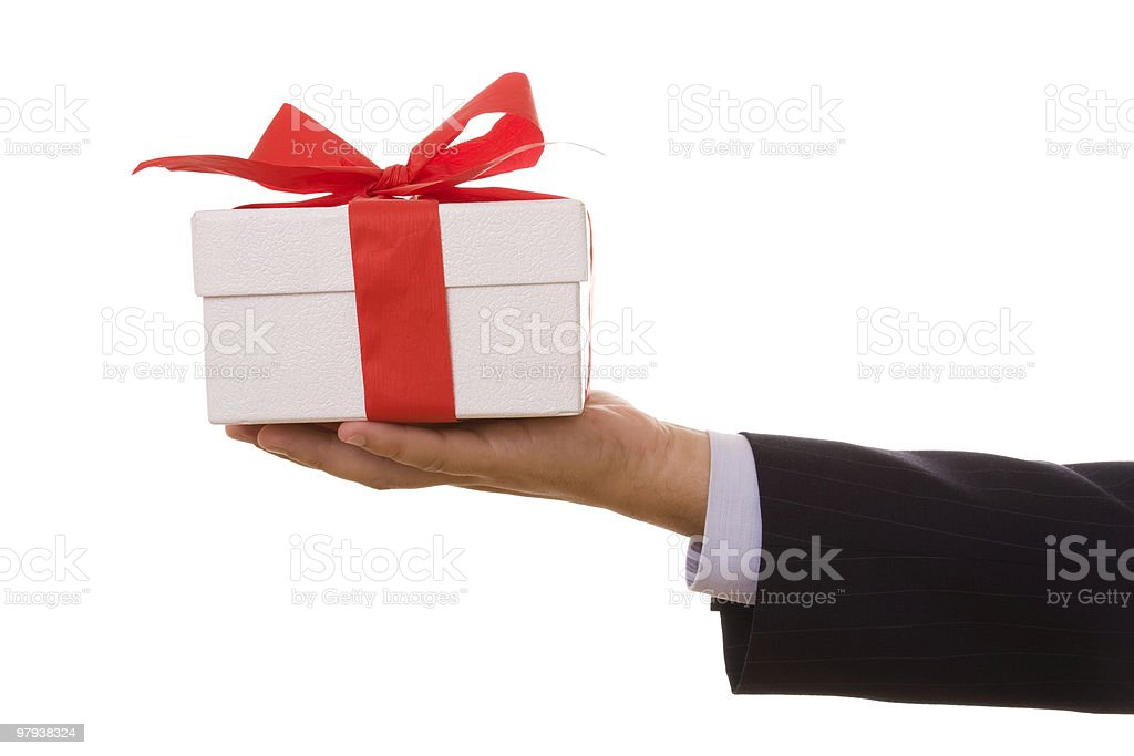 A man holding a wrapped present royalty-free stock photo