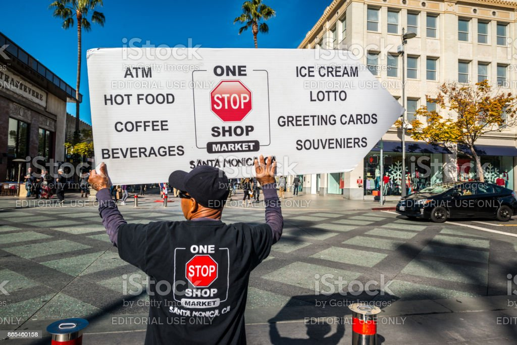 Man Holding advertisement of different services in Santa Monica Downtown, USA stock photo