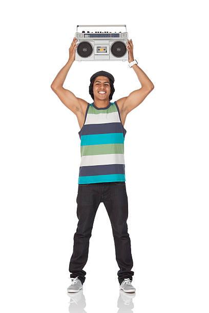 Man holding aloft a boom box stock photo
