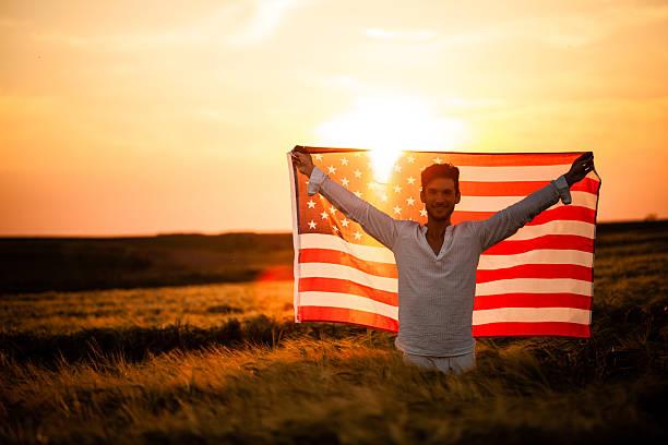 Man holding American flag stock photo