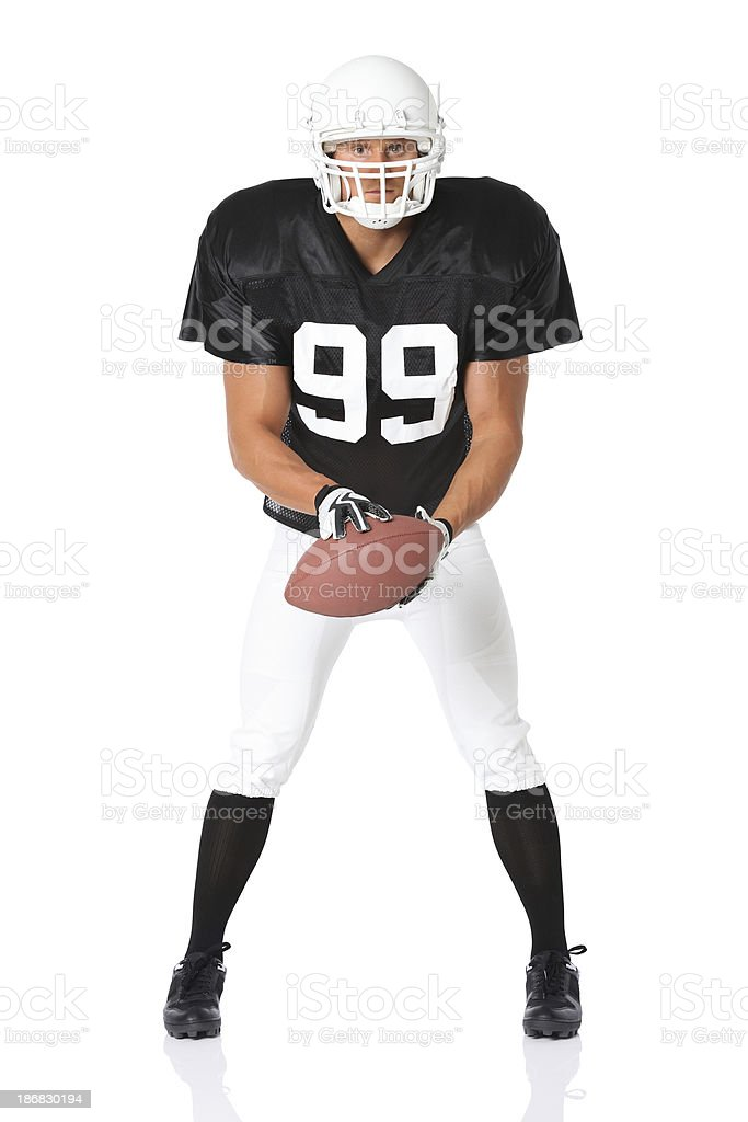 Man holding an american football royalty-free stock photo