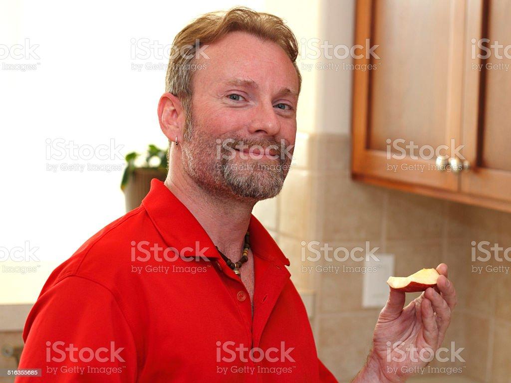 Man Holding an Apple Slice stock photo