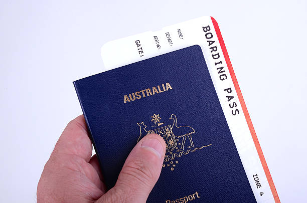 Man holding an Australian passport stock photo