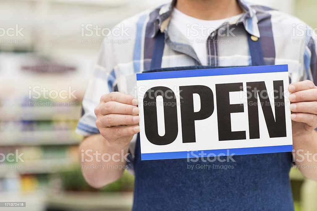 Man Holding an Open Signboard royalty-free stock photo