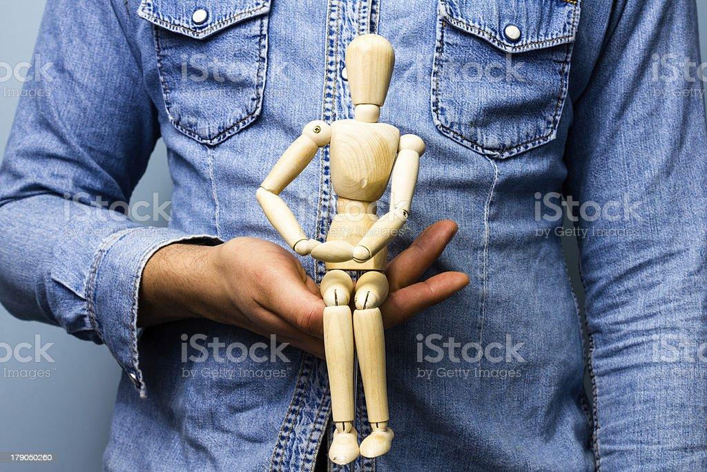 Man holding artist's dummy royalty-free stock photo