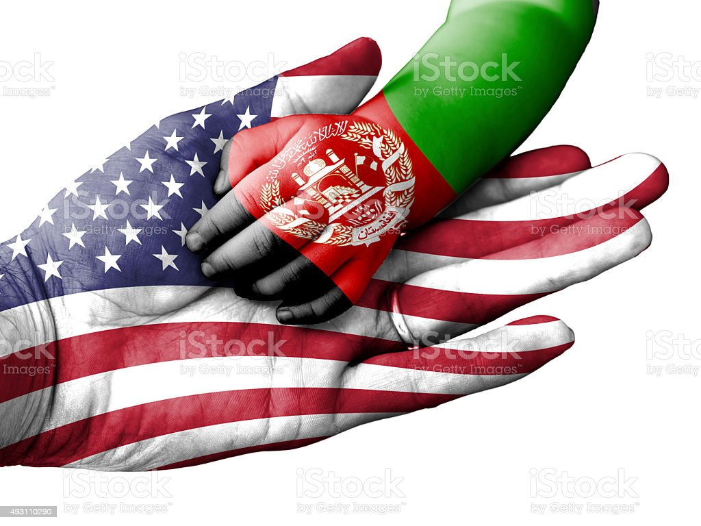 Man holding baby hand, United States and Afghanistan flags overlaid stock photo