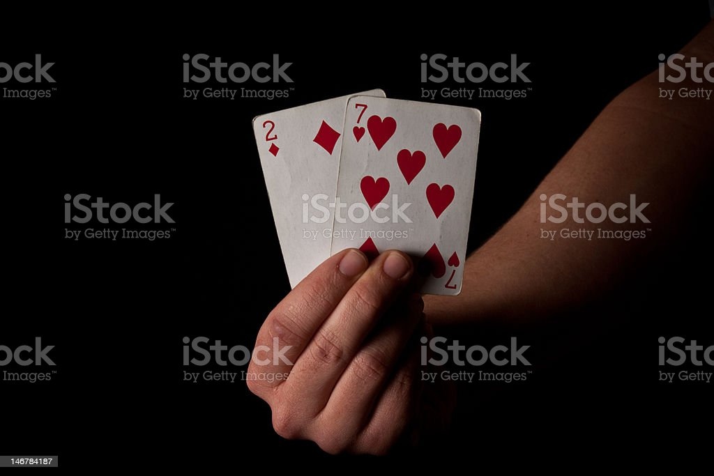 Man Holding Bad Cards - Two and Seven royalty-free stock photo