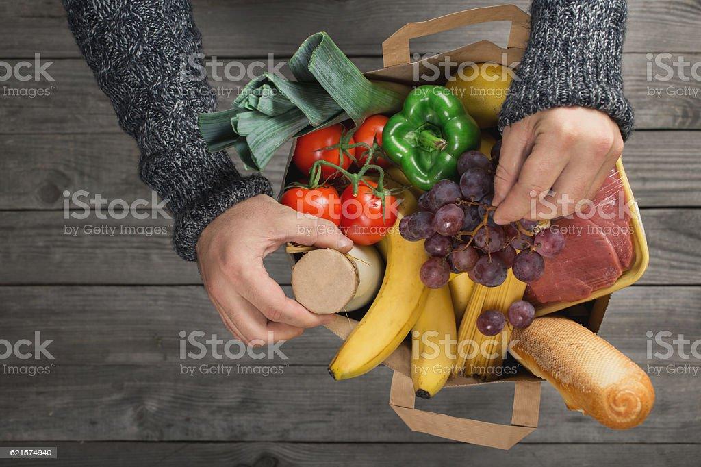 Man holding bag full of different healthy food photo libre de droits
