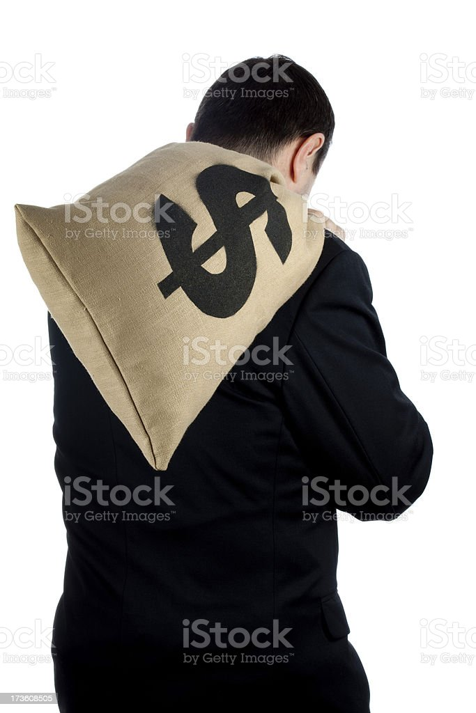 Man holding bag of dollars on his back stock photo