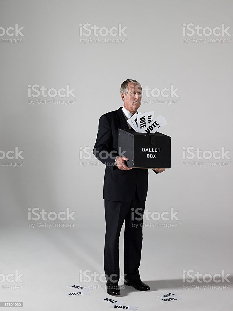Man holding ballot box royalty-free stock photo
