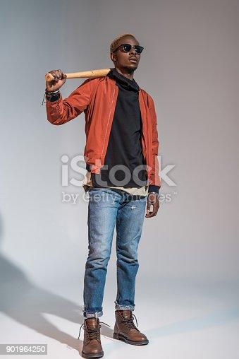 istock man holding baseball bat 901964250
