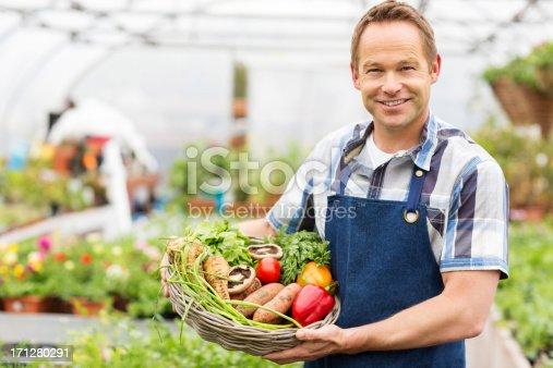 istock Man Holding Basket Of Fresh Vegetables 171280291