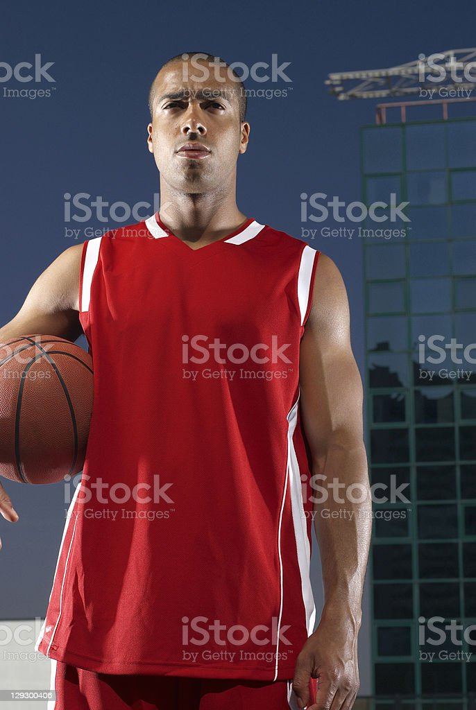 Man holding basketball on rooftop royalty-free stock photo