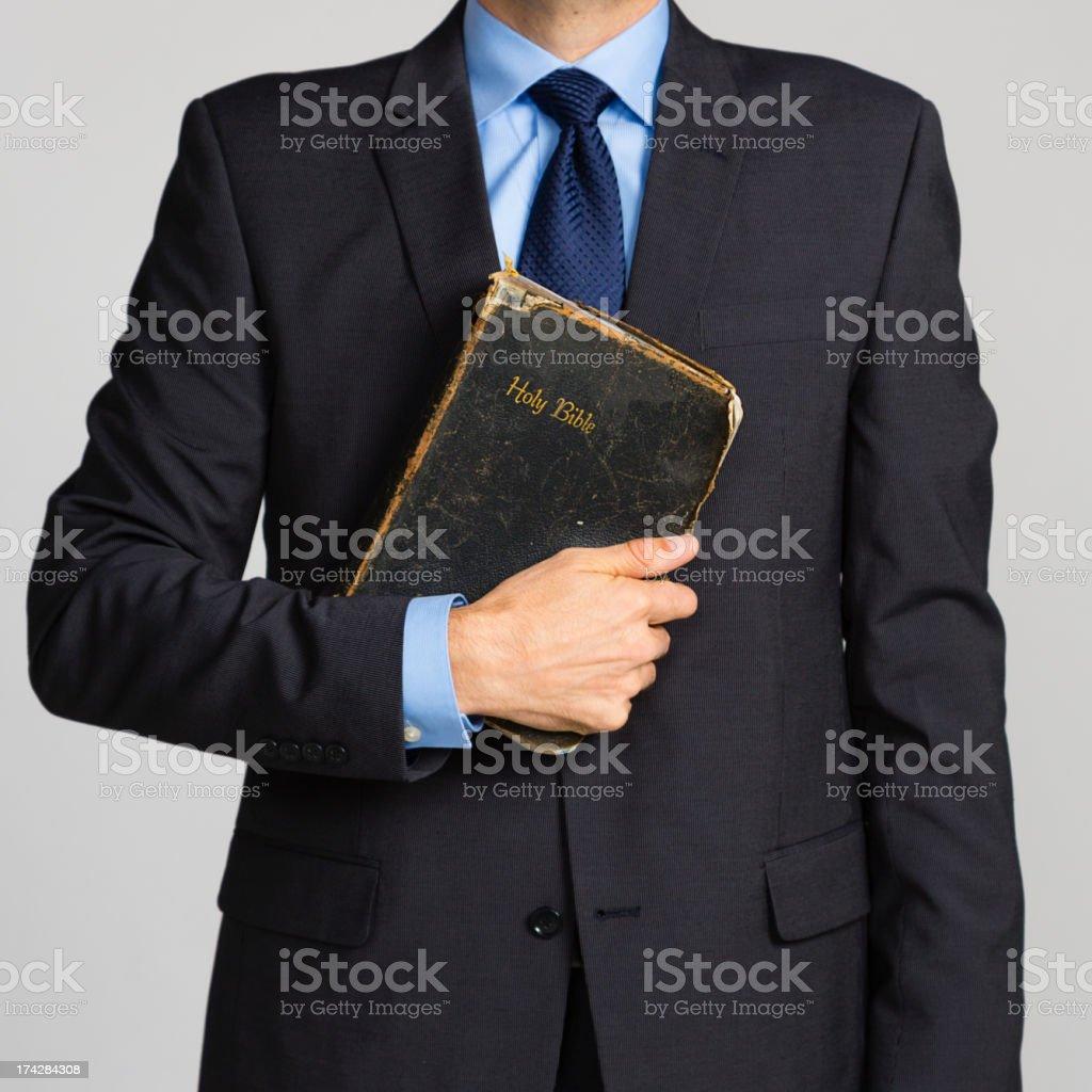 Man Holding Bible stock photo
