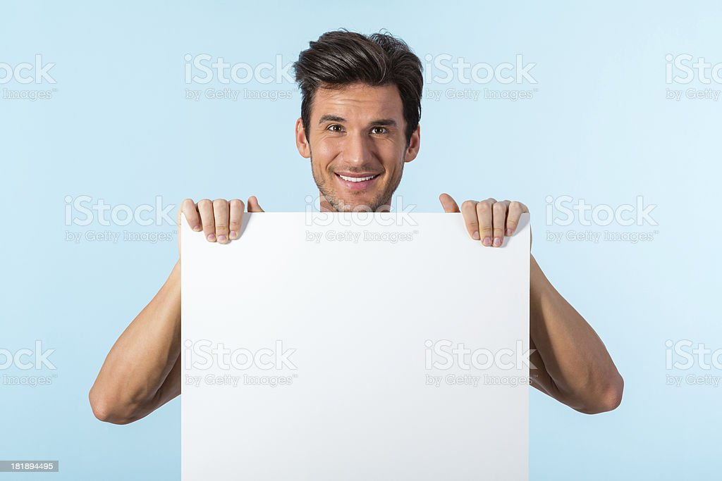 Man holding blank banner royalty-free stock photo