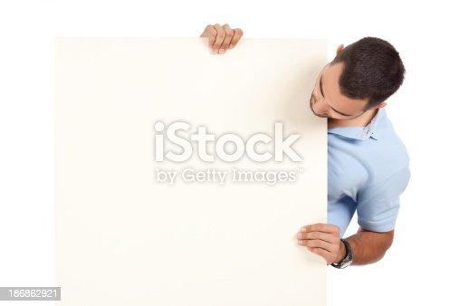 istock Man holding blank billboard. 186862921
