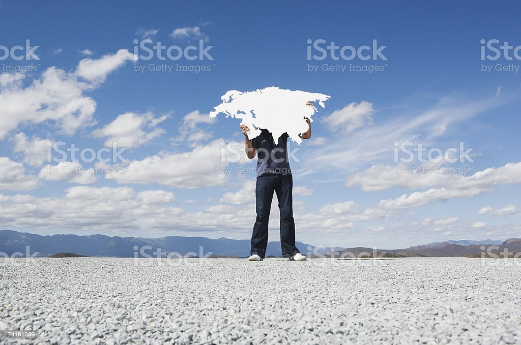 Man holding blank continent stock photo