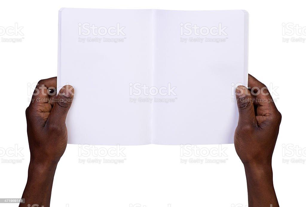 Man holding blank notebook stock photo