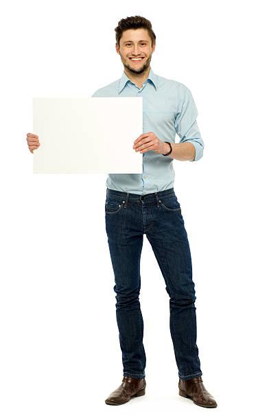 Man holding blank poster stock photo