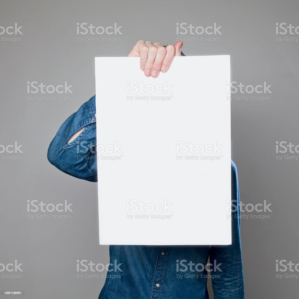 Man holding blank poster royalty-free stock photo