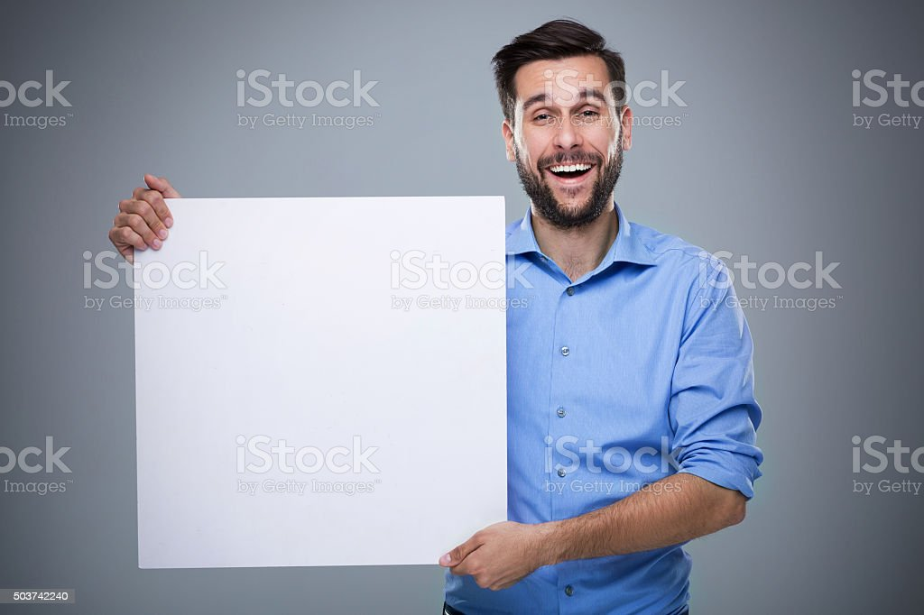 Man holding blank poster stock photo