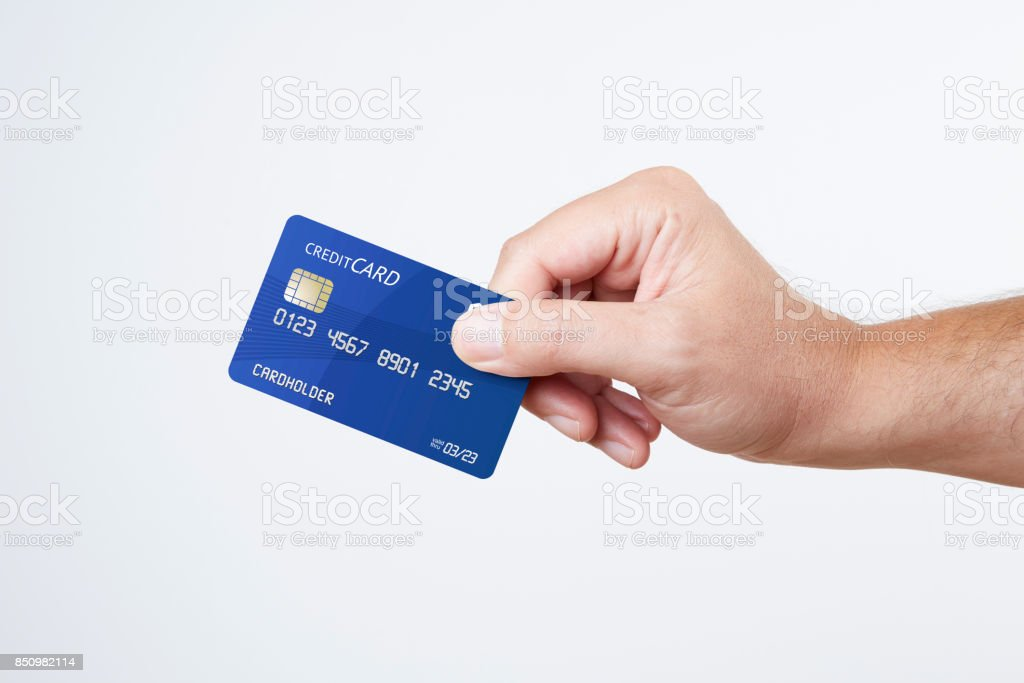 Man holding blue credit card stock photo
