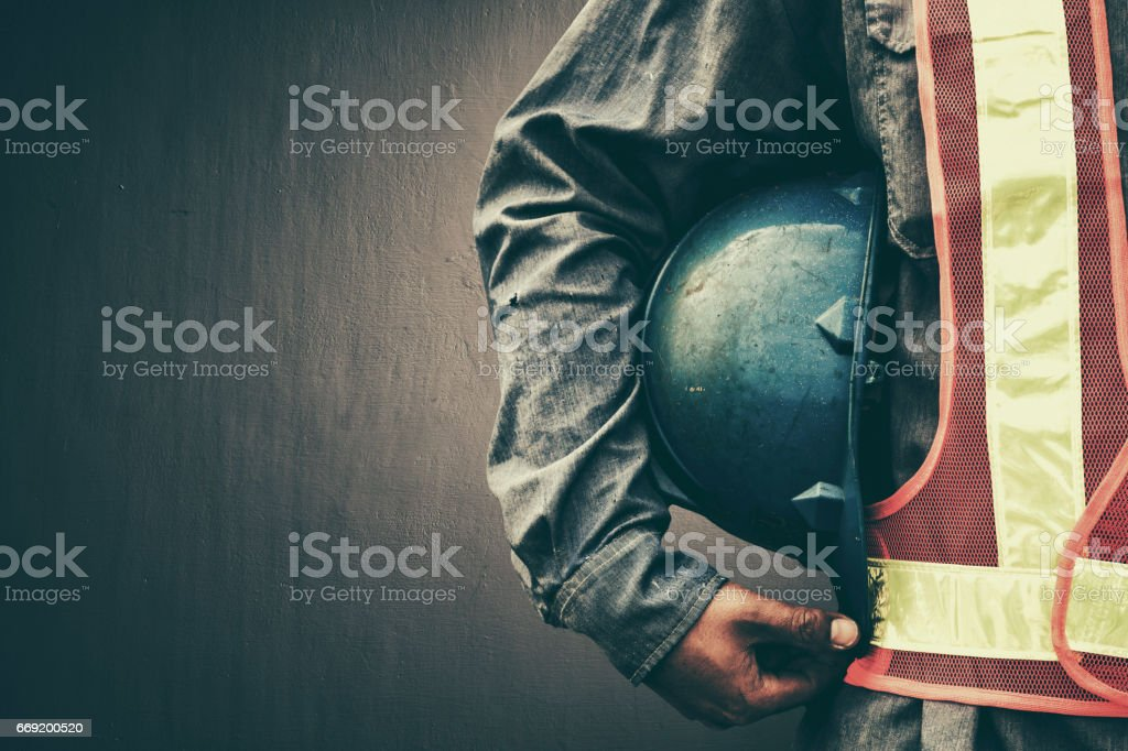 Man holding blue helmet close up stock photo