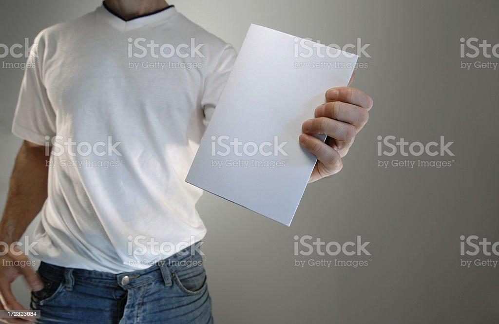 man holding book foto