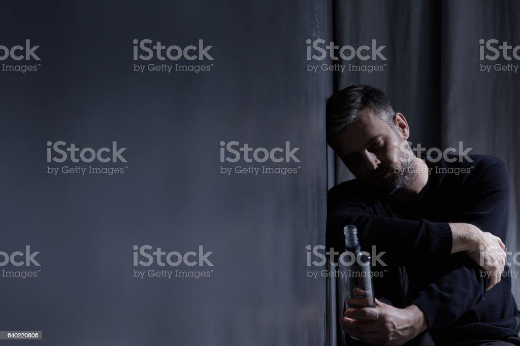 Man holding bottle of alcohol stock photo