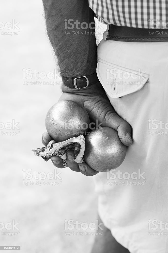 Man Holding Boule Balls stock photo
