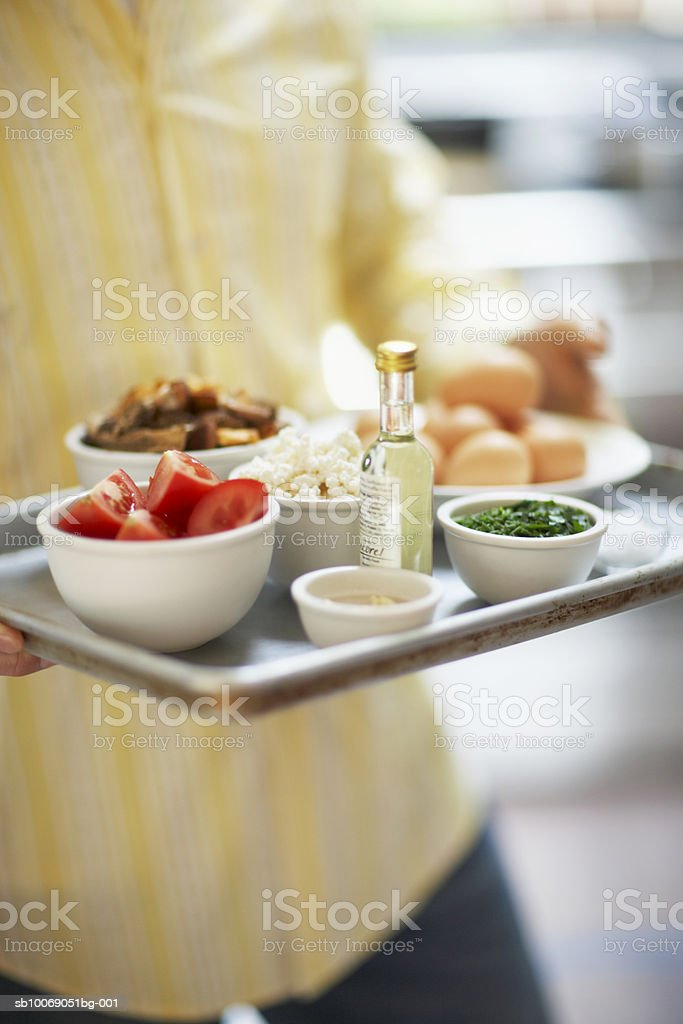 Man holding bowl with ingredients, mid section foto stock royalty-free
