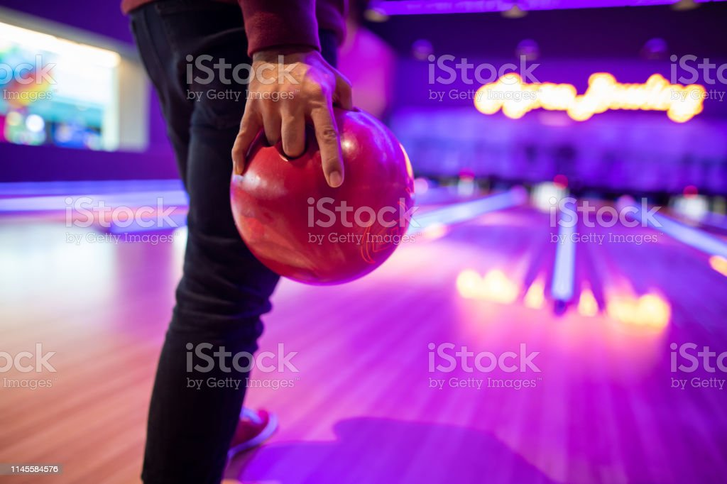 Man holding bowling ball