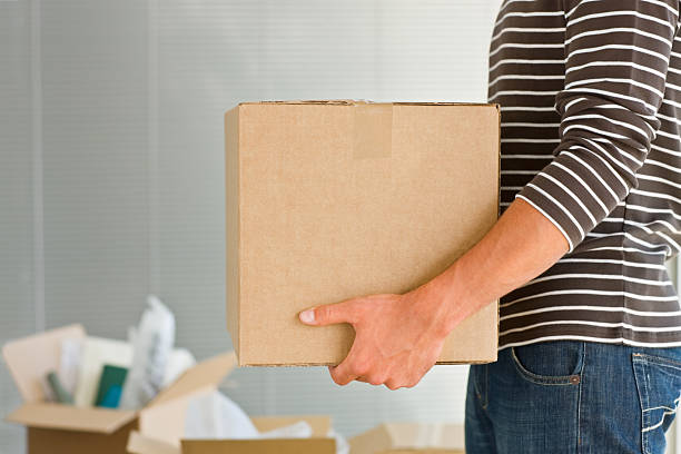 Man holding box Closeup of Man holding box clothes in box stock pictures, royalty-free photos & images