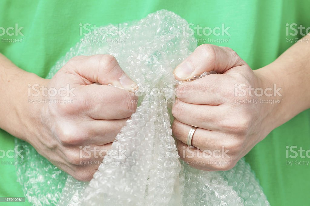 Man holding bubble wrap stock photo