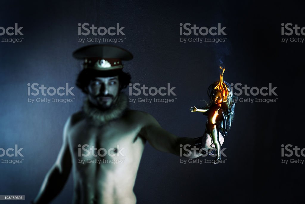 Man Holding Burning Doll royalty-free stock photo