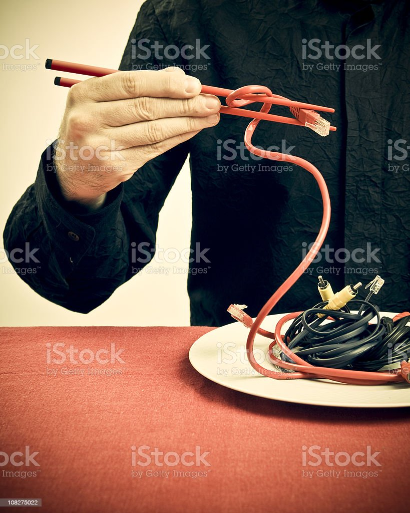 Man Holding Cables with Chop Sticks royalty-free stock photo