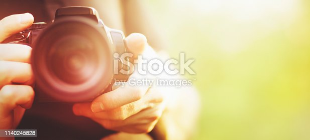 man holding camera close-up
