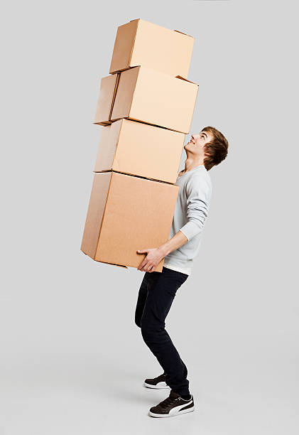 man holding card boxes - carrying stock pictures, royalty-free photos & images