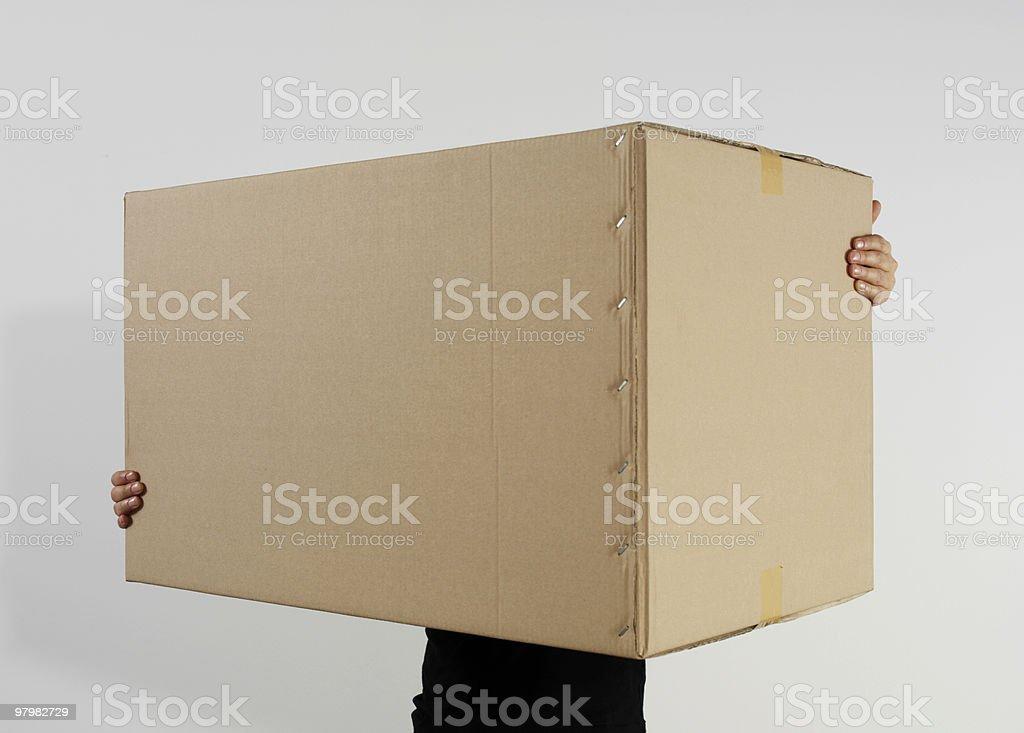 Man Holding Cardboard Box stock photo