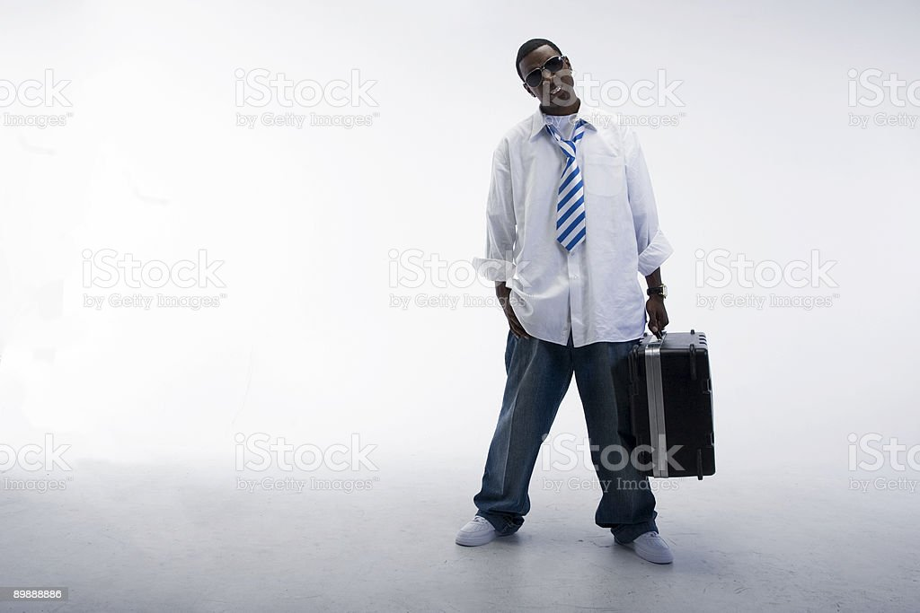 Man holding case in studio royalty-free stock photo