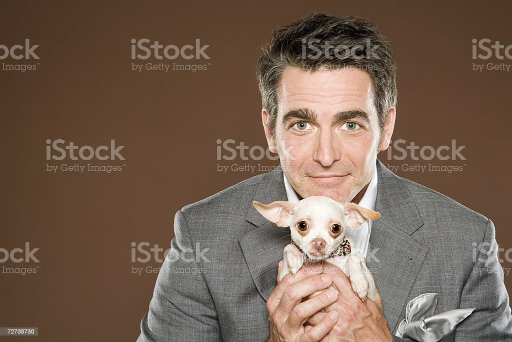 Man holding Chihuahua royalty-free stock photo