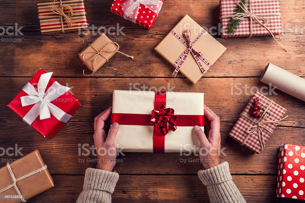Man holding Christmas present stock photo