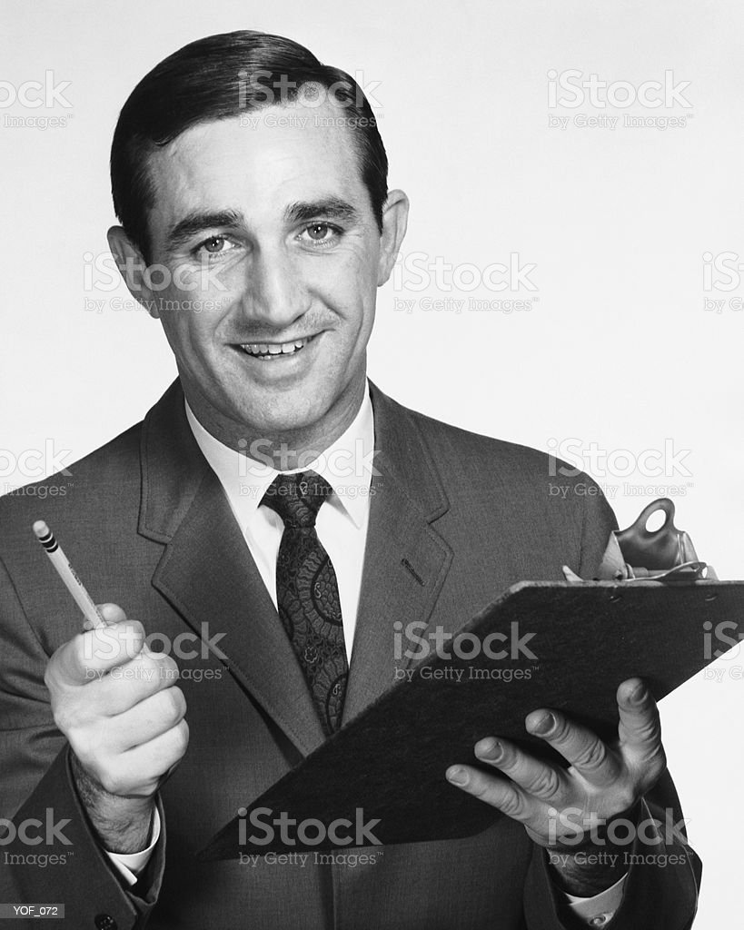 Man holding clipboard and pencil royalty free stockfoto