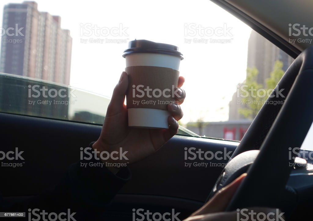 Man holding coffee in car royalty-free stock photo